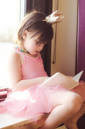 fancy girl: little girl reading Stock Photo