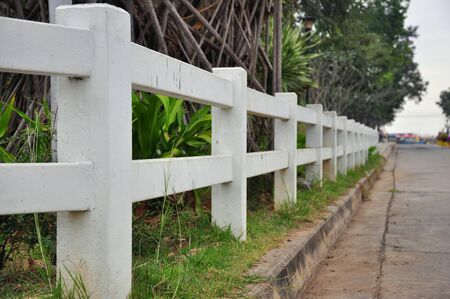 white stockade wooden white fence Stock Photo