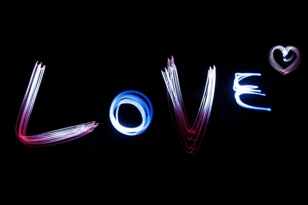 LOVE  alphabet  created by light over black background photo