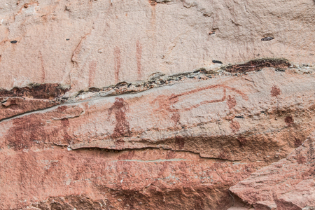 Ancient paintings on the cliff at Pha Taem Ubon Ratchathani Northeast of Thailand. Stock Photo