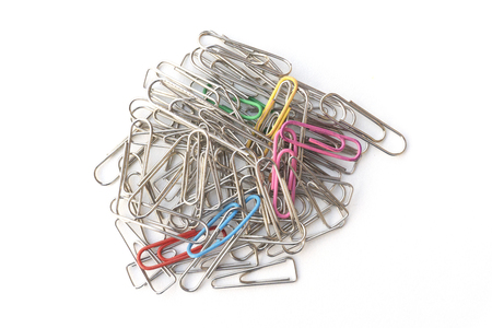 Multi colored paper clips on white background
