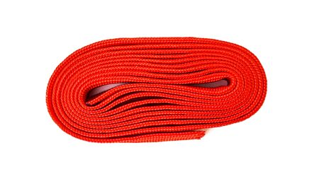 Red rope on white background. Fabric rope in red color folded in a coil.