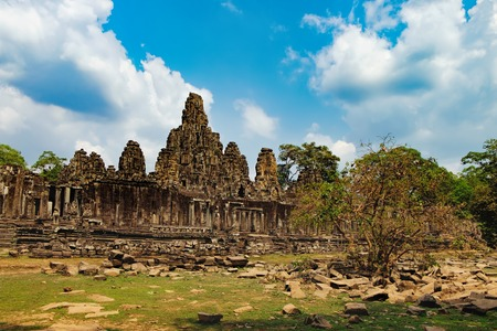 prasat bayon: Prasat Bayon with smiling stone faces is the central temple of Angkor Thom Complex, Siem Reap, Cambodia. Ancient Khmer architecture and famous Cambodian landmark, World Heritage. Stock Photo