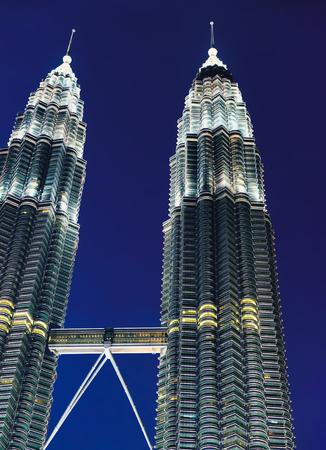 Kuala Lumpur, Malaysia - February 10, 2016: The most popular tourist destination in Malaysian capital - Petronas Twin Towers at night.
