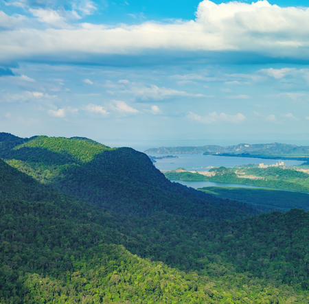 View of blue sky, sea and mountain seen from Cable Car viewpoint, Langkawi, Malaysia. Picturesque landscape with tropical forest, beaches, small Islands in waters of Strait of Malacca