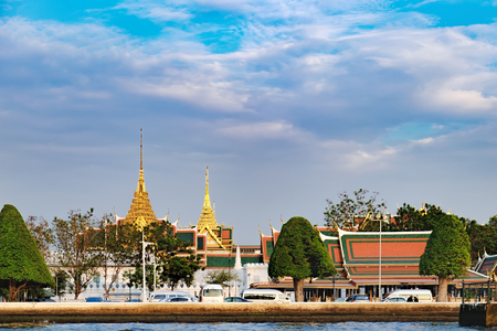 Classical Thai architecture of Grand Palace on Chao Phraya River in Bangkok, Thailand.