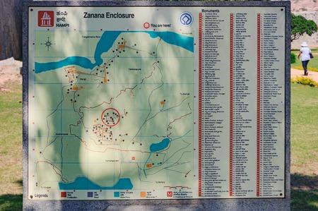 Hampi, India - November 20, 2012: Vintage sign with old map of the ancient ruins of Zanana Enclosure in Hampi, Karnataka, India.