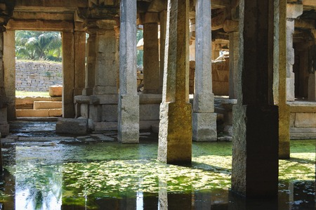 Flooded dark interior space of Prasanna Virupaksha temple is also known as the Underground Shiva Temple in Hampi, Karnataka, India. Stock Photo