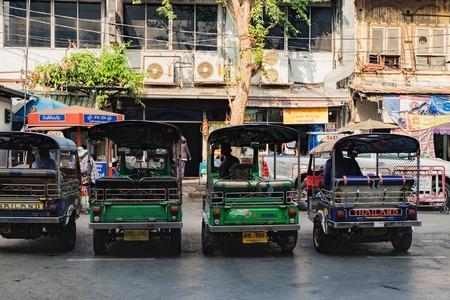 streetlife: Bangkok, Thailand - January 29, 2016: Tuk tuk driver waiting for passengers lined up in a row, Bangkok, Thailand Editorial