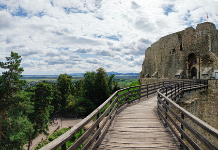Wooden bridge held by massive rock pillars leads the way into the Neamt Citadel is a medieval fortress located in north-eastern part of Romania, near Targu Neamt, Neamt County. Reklamní fotografie