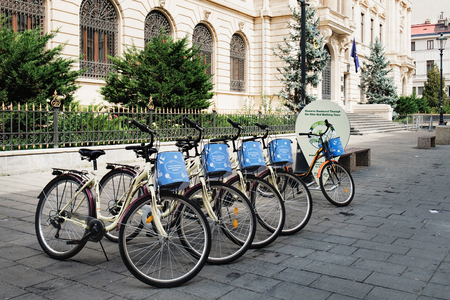 Bucharest, Romania - September 9, 2017: City bike stand with row of bicycles for rent at the historical center Lipscani Street in Bucharest, Romania. Editorial