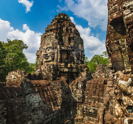Prasat Bayon with smiling stone faces is the central temple of Angkor Thom Complex, Siem Reap, Cambodia. Ancient Khmer temple, famous Cambodian landmark Фото со стока