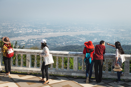 Tourists enjoy the view of the city Chiang Mai from the viewing platform of the Wat Phra That Doi Suthep in Thailand.