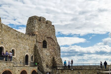 Targu Neamt, Romania - September 5, 2017: Tourists walk and enjoy Inner Court of medieval Neamt Citadel in Targu Neamt, Romania Editorial