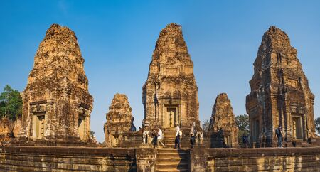 Siem Reap, Cambodia - February 8, 2019: East Mebon Temple in Angkor Complex, Siem Reap, Cambodia with walking tourists. Ancient Khmer architecture, famous Cambodian landmark, World Heritage
