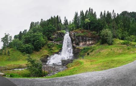 Picturesque view of Steinsdalfossen waterfall in Steine, Norway. The landscape of Norway in the summer.