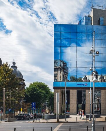 Bucharest, Romania - September 9, 2017: Modern architecture of Romanian Commercial Bank located on Calea Victoriei Street the historical center of Bucharest, Romania.