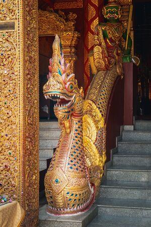 Closeup of Naga as golden art in Thai style near Wat Si Suphan in Chiang Mai, Thailand.