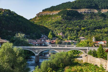 View of the Vladishki bridge over Yantra river and typical terrace architecture in Veliko Tarnovo, Bulgaria Stock Photo
