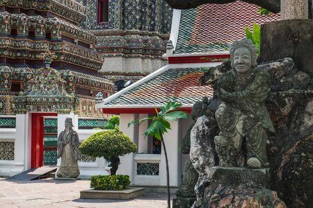 Detailed classical Thai statues in Wat Pho, Buddhist temple, Bangkok, Thailand.