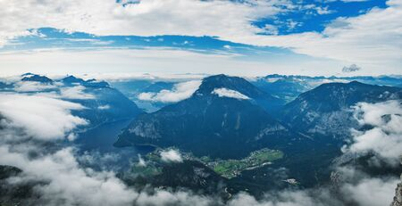 Panoramic summer view of Lake Hallstatt and surrounding mountains taken from viewing platform Five Fingers in Obertraun, Austria Stock Photo