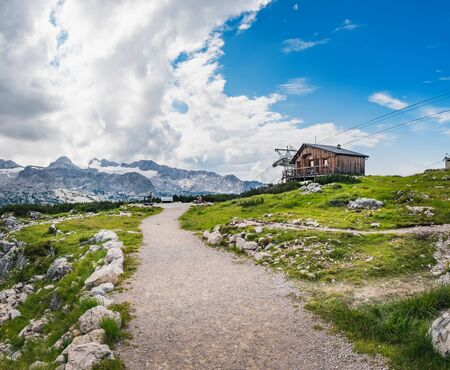 Panoramic summer view of winding path and wooden house in the Dachstein Mountains taken near Krippenstein cable car station in Upper Austria, Austria Zdjęcie Seryjne