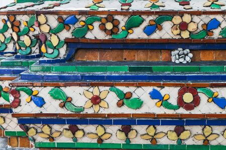 Details of ancient stupa in Wat Pho public temple, Bangkok, Thailand. Classical Thai architecture.
