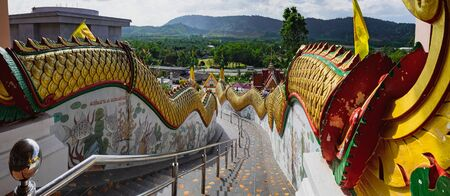 Ladder with dragons in public temple Wat Waree Banprot on Phet Kasem Road, Bang Non, Ranong district, Thailand