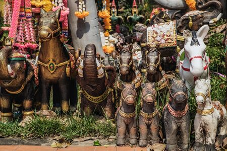 Animal statues decorated with flowers located near the Phra Nakhon Si Ayutthaya Provincial City Pillar Shrine. It is a small and mostly overseen temple in the historic district of Ayutthaya, Thailand.