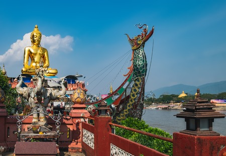 Big golden Buddha statue at Golden Triangle area along the Mekong river in Chiang Saen, Thailand