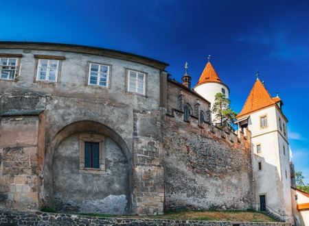 Panoramic summer view of famous medieval Krivoklat Castle in Bohemia, Czech Republic. It is royal castle museum, tourist destination and place for theatrical exhibitions. Editorial