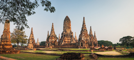 Tourists visit Wat Chai Watthana Ram Temple located in the historic district of Ayutthaya, Thailand.