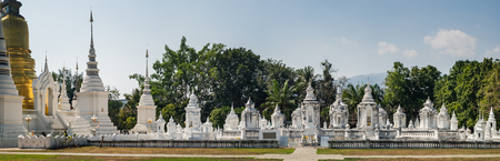 Panoramic view of golden and white pagoda at Wat Suan Dok Temple in Chiang Mai, Thailand.
