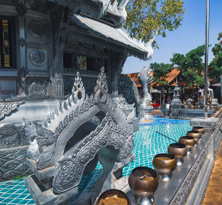 Wat Si Suphan has aluminium and silver decoration over delicate carving with stories of Buddhism, dharma puzzles, and the history of the temple and located in Chiang Mai, Thailand.