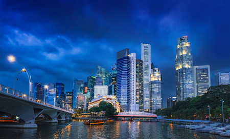 View of Singapore Skyline in Marina Bay, central business district at night.