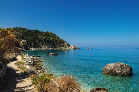 Idyllic sunny day on the rocky shore of north west coast of Lefkada island, Greece