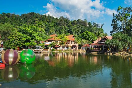 Oriental Village gateway to ride a cable-car up Mat Cingcang mountain. Luxury Paradise with lake, restaurants, hotels and shops for tourists