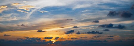Tropical dramatic sunset with cloudy sky. Beautiful bright afterglow. Natural background