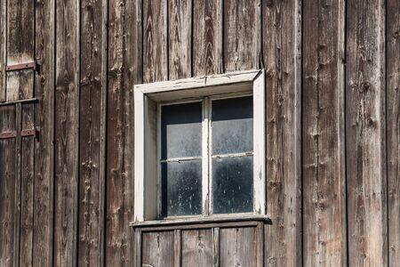 Window in an old wooden house in the Principality of Liechtenstein
