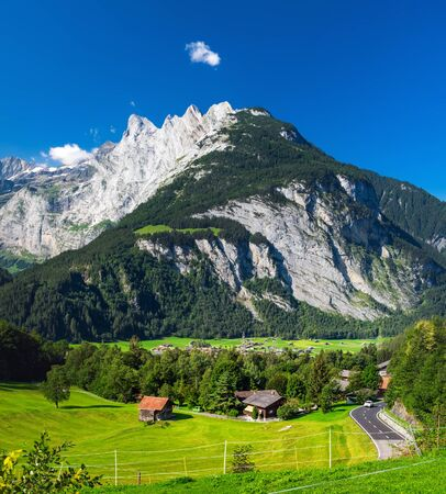 Rural landscape in the Swiss Alps. View of Innertkirchen, it is a village and municipality in the Interlaken-Oberhasli administrative district in the canton of Bern in Switzerland. Stock Photo