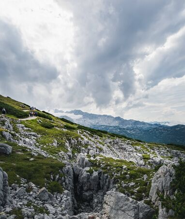 Panoramic summer view of winding path to Krippenstein cable car station in the Dachstein Mountains, Salzkammergut region, Upper Austria, Austria Stock Photo