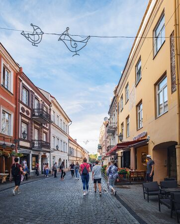 Vilnius, Lithuania - July 19, 2018: Old Pilies Street with cafes, shops and restaurants in the heart of the Old Town in Vilnius, Lithuania. 新聞圖片