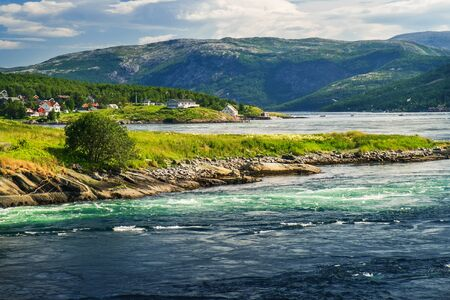 Norwegian summer landscape, stream view with whirlpools and waves near Saltstraumen bridge, Bodo, Nordland, Norway