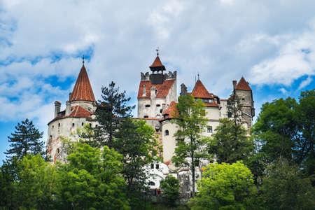 Bran or Dracula Castle in Transylvania, Romania under blue cloudy sky
