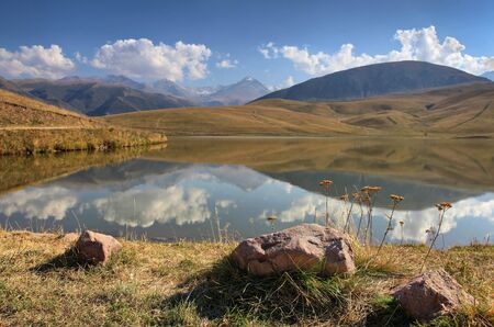 Autumn lake on a high-mountainous plateau Ush-Konur, Kazakhstan photo