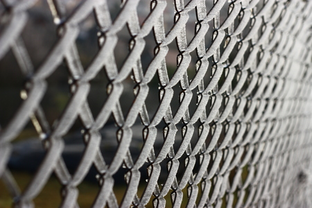 chain link fence: Frozen chain link fence in winter