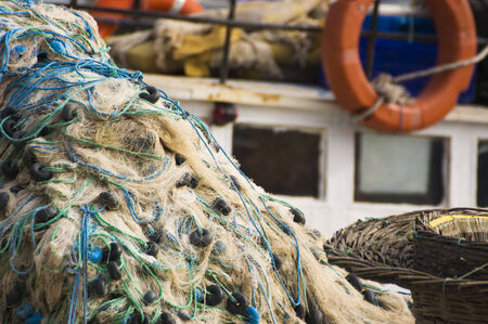 toils: Fishing net and boat