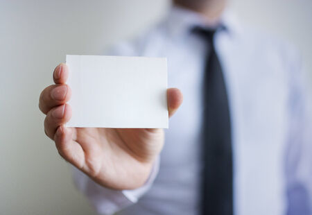 Man\'s hand showing blank card