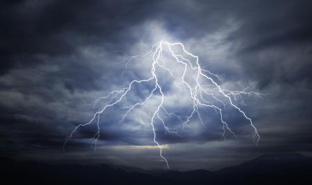 曇り空に落雷 写真素材