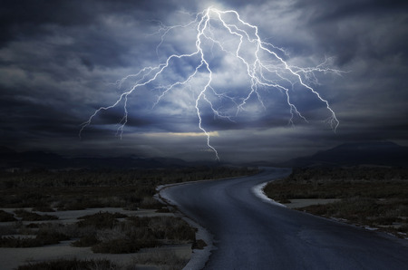 streak lightning: Thunderstorm over the Road